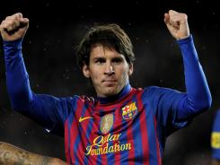 Barcelona's Lionel Messi celebrates his hat trick against Granada CF at the Camp Nou stadium in Barcelona.
