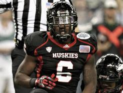 Northern Illinois linebacker Jamaal Bass was charged with assault for allegedly ran into a Toledo band member.
