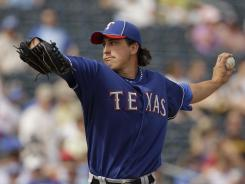 Derek Holland was 16-5 with the Rangers in 2011.