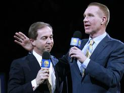 Golden State Warriors owner Joe Lacob, left, was booed mercilessly during Monday's halftime ceremonies to retire the No. 17 jersey of Chris Mullin, right. Lacob traded star guard Monta Ellis last week.