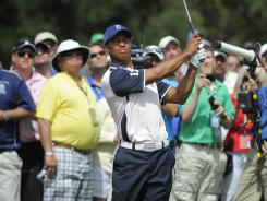 Tiger Woods plays the second hole during the second day of the two-day Tavistock Cup exhibition in Orlando.