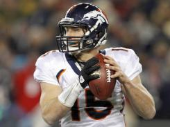 Tim Tebow, looking to pass for the Broncos in a playoff game against the Patriots on Jan. 14, will be the backup to Mark Sanchez with the Jets.