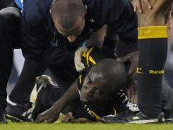 Bolton's medical staff rushes to revive Fabrice Muamba, who suffered cardiac arrest during the Wanderer's match on March 17.