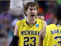 Michigan basketball coach John Beilein announced today that sophomore forward Evan Smotrycz (23),sophomore forward Colton Christian and freshman guard Carlton Brundidge have the Wolverine basketball program and transfer to another school.