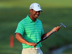 Tiger Woods of the USA enjoys his pro-am round Wednesday ahead of the Arnold Palmer Invitational.