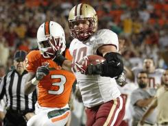 Boston's Luke Kuechly returns an interception for a touchdown on Nov. 25, 2011 in Miami.