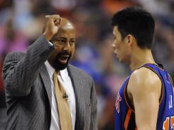 Contrary to New York media predictions, Knicks guard Jeremy Lin, right, is working out well for interim coach Mike Woodson, left.