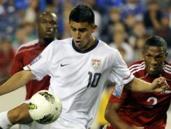 Joe Corona (10) hammers home on of his three goal's in the United States' 6-0 thrashing of Cuba.