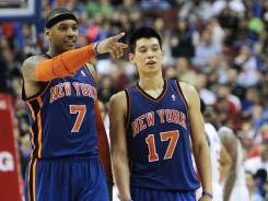 New York Knicks forward Carmelo Anthony, left, and guard Jeremy Lin, right, are working much better together under interim coach Mike Woodson.