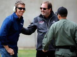 Carl Edwards shares a laugh with Texas Motor Speedway President Eddie Gossage during a training event with members of the Fort Worth SWAT team on March 21.