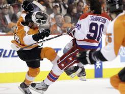 Philadelphia's Matt Read, left, and Washington's Marcus Johansson collide in the Flyers' 2-1 shootout win over the Capitals on Thursday at Philadelphia.