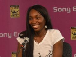 Venus Williams flashes a grin in her post-match news conference Wednesday after winning her first singles match since the U.S. Open in August.