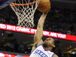 76ers forward Andre Iguodala dunks over Celtics forward Paul Pierce during the first quarter of their game Friday. Philadelphia won behind a strong performance from Elton Brand, who poured in 20 points.