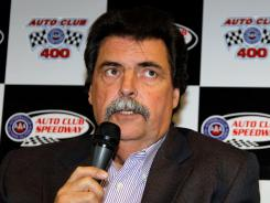 NASCAR President Mike Helton spoke Friday at Auto Club Speedway about the overturned penalty to Jimmie Johnson's team and didn't seem pleased. &quot;I'll keep my personal reaction to myself,&quot; he said.