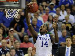 Kentucky forward Michael Kidd-Gilchrist (14) splits the Indiana defense to lay in two of his 24 points. He added 10 rebounds as the Wildcats advanced to the Elite Eight.
