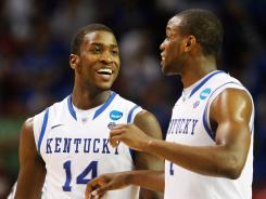 Kentucky's Michael Kidd-Gilchrist (14) and Darius Miller celebrate their 102-90 win over Indiana.