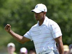 Tiger Woods pumps his fist after sinking a birdie putt on the sixth hole during the second round of the Arnold Palmer Invitational.