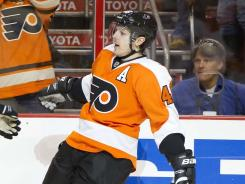 Danny Briere celebrates the second of his two goals that helped the Flyers clinch the Eastern Conference's third playoff spot.