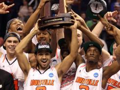 Louisville's Peyton Siva and Russ Smith celebrate with teammates after defeating the Gators 72-68 during the 2012 NCAA Men's Basketball West Regional Final.