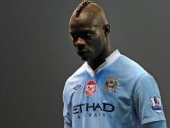 Manchester City's Mario Balotelli leaves the field after City drew with Stoke in, Stoke-on-Trent, England