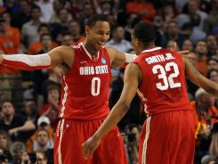 Ohio State teammates Jared Sullinger and Lenzelle Smith, Jr. celebrate toward the end of the game against the Syracuse.