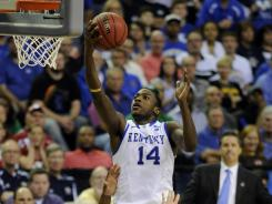 Wildcats forward Michael Kidd-Gilchrist lays the ball up past Indiana Hoosiers guard Remy Abell (23) in the second half during the semifinals of the south regional.