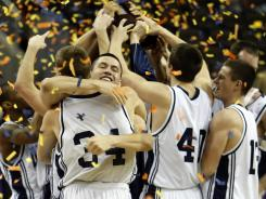 Western Washington players celebrate amid the confetti as the Vikings claim their first national title.
