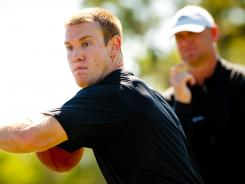 NFL draft prospect Ryan Tannehill, front, works out under the watchful eye of Chris Weinke at IMG Madden Football Academy.