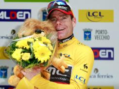 Australia's Cadel Evans celebrates on the podium after he won the Porto-Vecchio Criterium on Sunday in the French Mediterranean island of Corsica. Evans won the race ahead of compatriot Michael Rogers and Norway's Lars-Petter Nordhaug.