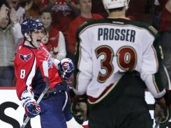 Wild defenseman Nate Prosser (39) watches Capitals left wing Alex Ovechkin (8) celebrate a goal during the third period. Ovechkin has scored nine goals over the past seven games.