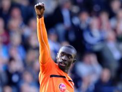 Newcastle United's Papiss Cisse celebrates scoring his second goal during the English Premier League match against West Bromwich Albion on Sunday.