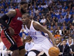 Kevin Durant (35) and the Thunder got the best of LeBron James and the Heat in a matchup of two of the league's top teams and MVP candidates.