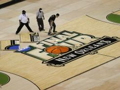 Connor Sports Floor installs the custom built NCAA men's basketball tournament Final Four floor at the Superdome in New Orleans.