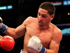 Danny Garcia won the WBC title Saturday night by defeating Erik Morales by unanimous decision.