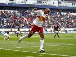 Thierry Henry #14 of New York celebrates his goal against the Colorado Rapids during their game at Red Bull Arena on March 25, 2012 in Harrison, New Jersey. Henry scored two goals and assited another in the Red Bulls victory.