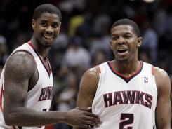 Joe Johnson (2) had 37 points, and Marvin Williams added 16 in a game that tied for the third-longest in NBA history.