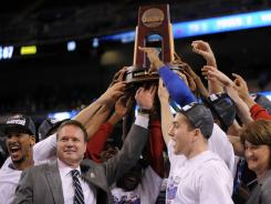 Kansas coach Bill Self and his players celebrate their win over North Carolina that clinched a berth in the Final Four.