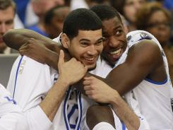 Kentucky's Eloy Vargas, left and Michael Kidd-Gilchrist celebrate the Wildcats' win that send them to the Final Four.