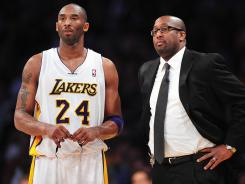 Los Angeles Lakers Kobe Bryant, left, and coach Mike Brown both say their relationship remains fine despite the superstar's benching in Sunday's loss to the Memphis Grizzlies.