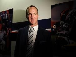 Peyton Manning finishes up his introductory news conference with the Broncos and turns his attention to working out.