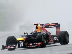 Red Bull-Renault driver Sebastian Vettel of Germany approaches the bend during the Malaysian Grand Prix. Vettel, the two-time defending F1 champion, finished 11th Sunday and is 17 points off the series lead.