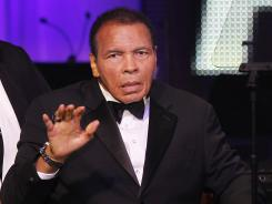 Muhammad Ali waves to the crowd Saturday, March 24, during the Celebrity Fight Night in Phoenix.