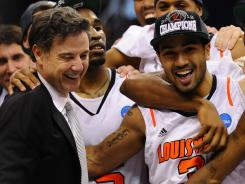 Louisville coach Rick Pitino, left, and Peyton Siva celebrate the Cardinals' victory that clinched a berth in the Final Four.