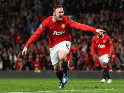Wayne Rooney of Manchester United celebrates as he scores the team's first goal during the Barclays Premier League match between Manchester United and Fulham at Old Trafford on Monday in Manchester, England.