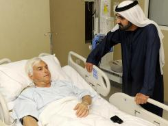 Sheikh Mohammed bin Rashid al-Maktoum, ruler of Dubai, visits Bob Baffert, who is widely recognized as one of the most successful trainers in the history of horse racing, at a local hospital in Dubai on Monday. Baffert suffered a heart attack.