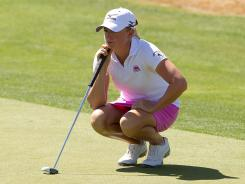 Stacy Lewis, lining up a putt at the Founders Cup, defends her title this week at the Kraft Nabisco Championship.