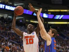 Louisville's Gorgui Dieng goes up against Florida's Erik Murphy during the West Regional final.