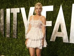 Maria Sharapova, arrives at the Vanity Fair Oscar Party, says doing the red carpet is mortifying.