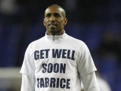 Tottenham Hotspur's Jermain Defoe warms up before kick off wearing get well t-shirt for Fabrice Muamba on March 21. Muamba suffered a heart attack at White Hart Lane during an English Premier League football match between Tottenham Hotspur and Stoke City.