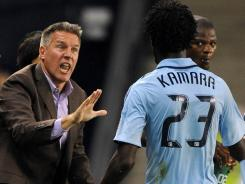 Peter Vermes, left, gives instructions to Sporting KC midfielder Kei Kamara during the second half against F.C. Dallas on March 25.